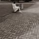 Woman sat on bench with cigarette