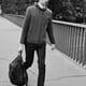 man walking with bag