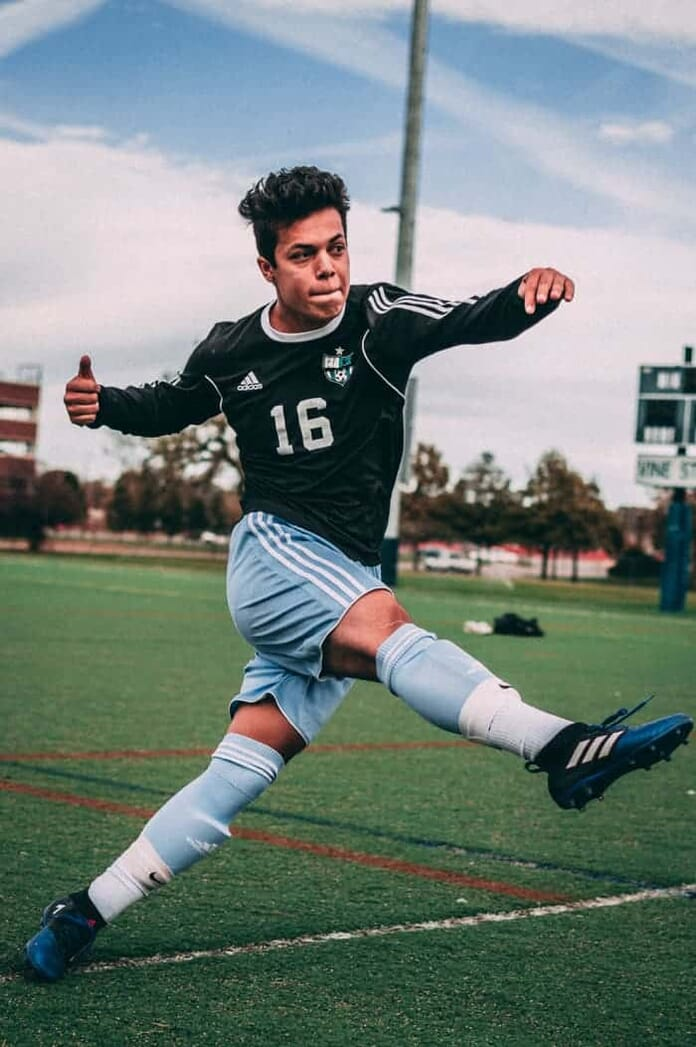 Soccer player, captured at a high shutter speed to freeze the moment.