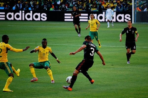 Mexico - South Africa Match at Soccer City by Celso FLORES