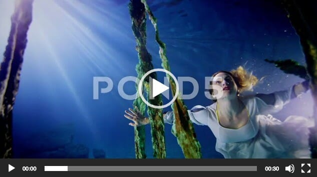 Beautiful Mysterious Underwater Woman In White Dress