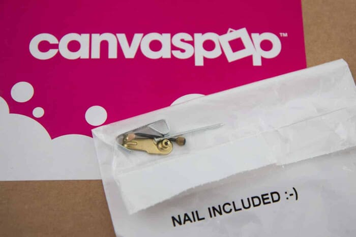 CanvasPop Ships their Canvas with Nails. That's pretty cool indeed.