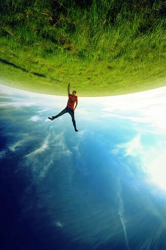 Forced perspective image of a man holding the earth