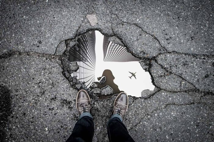 Forced perspective photography of a puddle in New York
