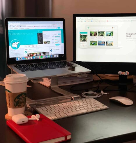 The ideal setup: coffee, laptop, desktop monitor. Managing your social media channels will take time, but it can be worth the investment when done right.