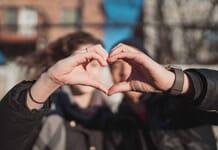 Couple creating a Hand Heart / Matt Nelson on Unsplash