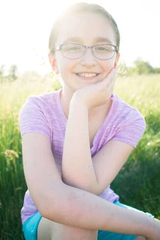 portrait photography of girl in field