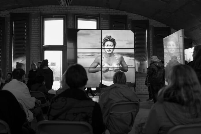 People viewing Annie Leibovitz exhibition