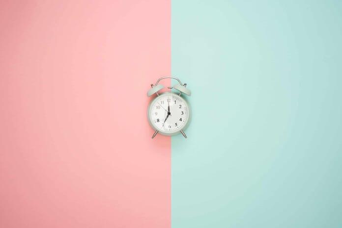 clock on colors flat lay