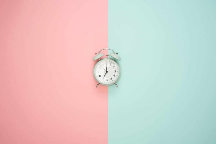 clock on colors flat lay