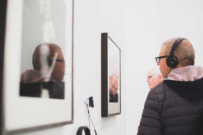 man viewing photo