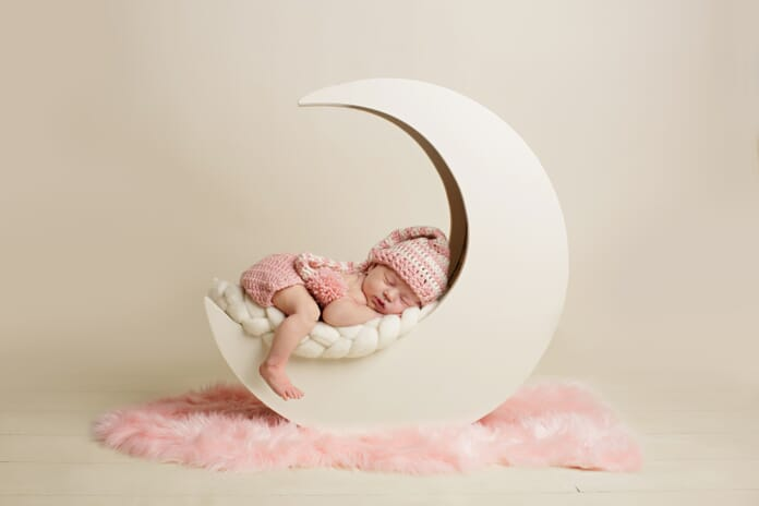 baby on prop newborn photography tips