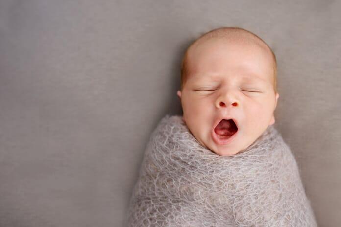Baby yawning newborn photography tips
