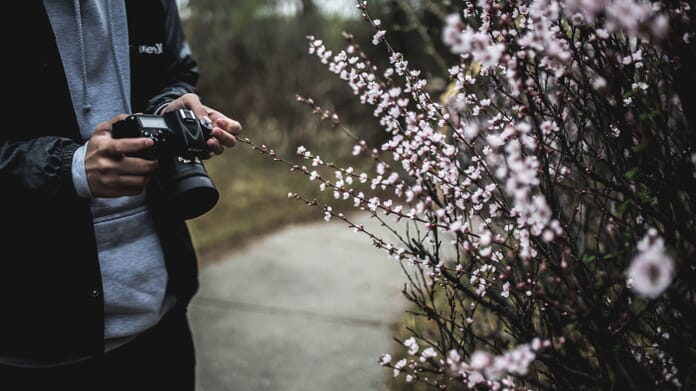 photographer with DSLR