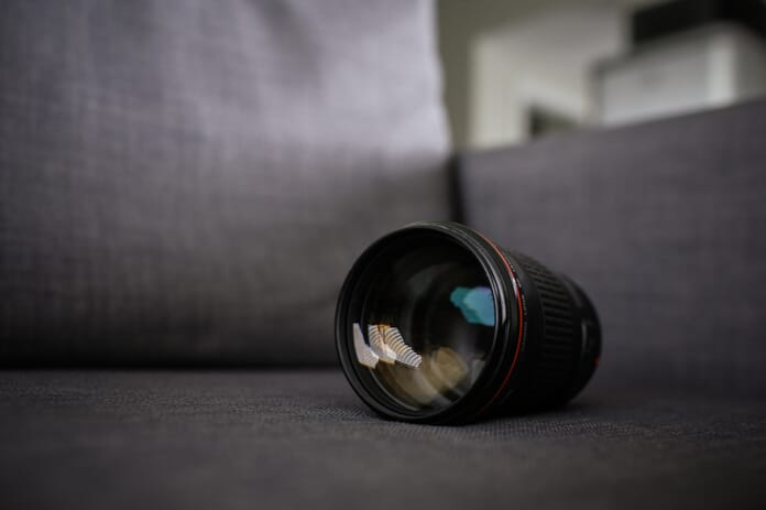 lens on couch photography gear