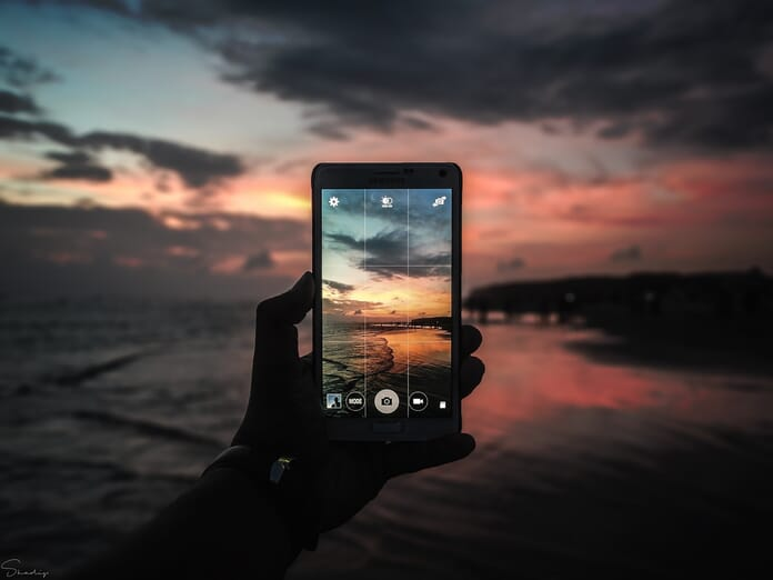 person taking picture with smartphone.