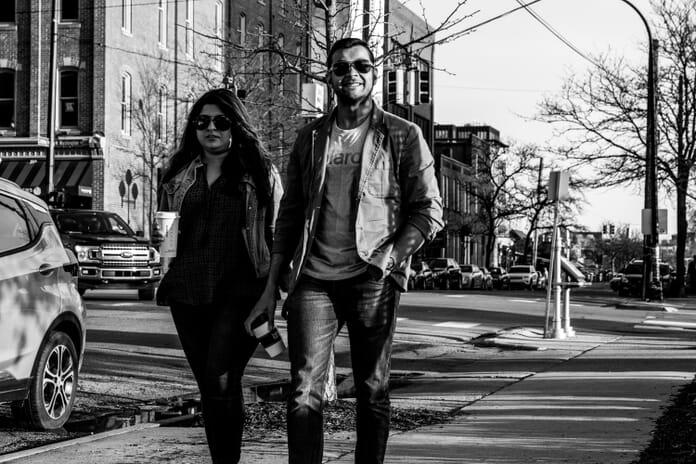 Couple walking by street photo