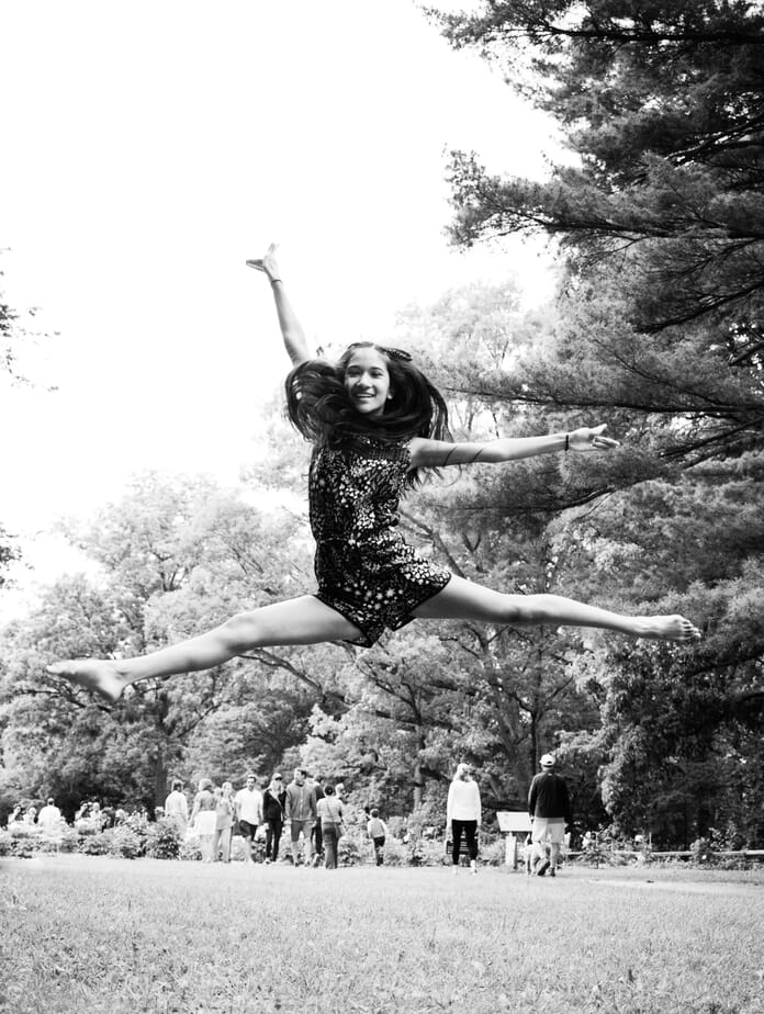 black and white girl jumping